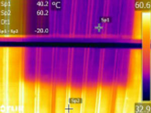 The Flir thermal camera shows that the roof under the coated area is 40°C and adjacent uncoated roof area is 60°C during a hot summer day